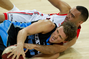 Sky City Breakers Daryl Corletto clashes with Perth Wildcats Everard Bartlett.  Photo / Richard Robinson