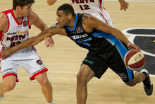 Corey Webster clashes with the Perth Wildcats Damien Martin.  Photo / Richard Robinson.