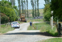 Police at the scene of a fatal stabbing north of Levin. Photo / Alecia Bailey