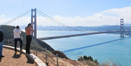 Tourists get a perfect shot of the Golden Gate Bridge at the entrance to San Francisco Bay. Fog would have prevented them seeing the bridge earlier in the day. Photo / Alex Robertson