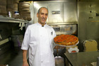 Joe Sheena, of Pizzapapalis in Detroit, shows off one of his deep-dish specialties. Photo / Supplied