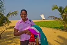 Chandrare sells sarongs at the beach at Negumbo, Sri Lanka. Photo / Alex Robertson