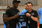 Richard Clarke gave Jamaican Olympic gold medallist Usain Bolt a Breakers singlet at training last year. Photo / Getty Images