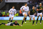 English fullback Alex Goode breaks away from South African defenders at Twickenham.  Photo / Getty Images