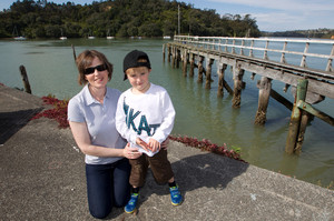 The sense of community is one of the reasons why Faith Faulk, pictured with son Harry, lives in Hobsonville Pt. Photo / Steven McNicholl