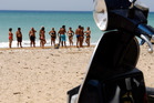 A paddle in the shallows of the beach at Ribera, Sicily, refreshes the feet of many tourists in Italy. Photo / Bloomberg