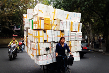 Commercial deliveries by bicycle pedallers are common sights in densely populated