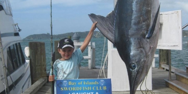 Hunter Scott with his 133.4kg striped marlin. Photo / Supplied