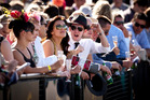 Racing fans take in the atmosphere at the Karaka Million at Ellerslie yesterday. Photo / Dean Purcell