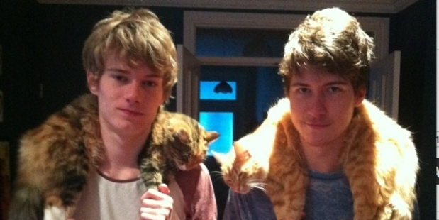 "Lynley Sheweiry writes: ""My sons, Michael and Troy Banbury, wearing their cats Alley and Dexter as scarves after a hard day of hunting NZ wildlife."" Photo / Supplied"