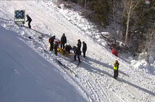 Rescuers take Rose Battersby off the mountain in Aspen.  Photo / ESPN