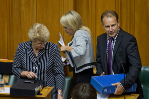 Dumped ministers Kate Wilkinson and Phil Heatley make way as newly promoted minister Nikki Kaye moves to her seat. Photo / Mark Mitchell