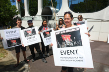 Event Cinema worker Mel Johnston protests with colleagues outside the Auckland headquarters. Photo / Chris Gorman 