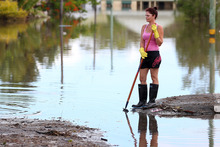 Residents and aid teams have begun to clean up in Bundaberg, where waters peaked at 9.53 metres before starting to recede.  Photo / Getty Images