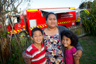 Katerina Itutu (left) with her children Levi (10) and Asenati (7) had to flee there home after a scrub fire at Clendon Park, Manurewa.  Photo / Richard Robinson