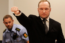 Anders Behring Breivik, makes a salute after arriving in the court room at a courthouse in Oslo during his trial. Photo / AP