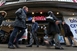 People walk outside a branch of HMV music store on Oxford Street in central London. Photo / AP