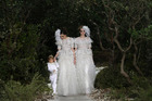 Ashleigh Good (right) is the first NZ model to close for Chanel. The brides walked in the Spring Summer 2013 Haute Couture collection in Paris this month. Photo / AP