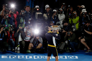 Novak Djokovic holds the Australian Open trophy after beating Andy Murray of Britain yesterday. Photo / AP