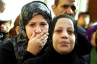 Relatives mourn during the funeral of policemen killed on Saturday in Port Said, in Cairo, Egypt. Photo / AP