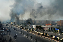 Smoke rises after Egyptian protesters clash with police in Port Said, Egypt. Photo / AP 