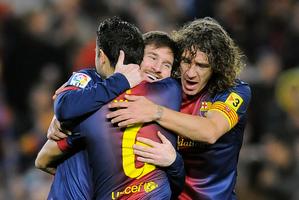 Messi celebrates with Barca teammates. Photo / AP