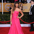 LOATH: Lea Michele in swamped in this fuschia Valentino gown.Photo / AP