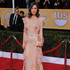 LIMBO: I do love Rose Byrne's risky fashion choices, but I'm feeling flummoxed by this floral Valentino.Photo / AP