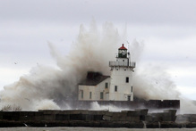 Rising oceans will make a merciless attack on man-made structures. Photo / AP