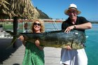 Kerre Woodham and Tom McIvor with a 26kg mahi mahi they caught off Moorea. Photo / Supplied
