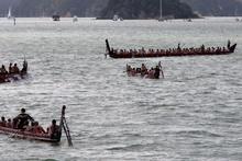 A waka fleet off Ti Beach. Photo / APN