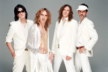 Glam rockers The Darkness will join Joan Jett and her band The Blackhearts for an Auckland show on April 9. Photo / Supplied 