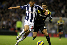 Peter Odemwingie wrestles the ball away from Chelsea's Eden Hazard. Photo / Offside.