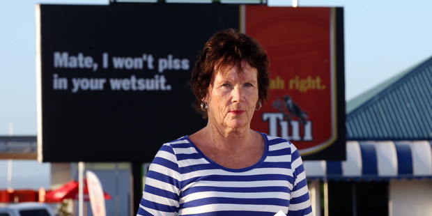 Barbara Mckelvie standing in front of the billboard she made an official complaint about. Photo / Duncan Brown