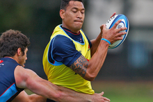 Israel Folau is tackled during a Waratahs training session. Photo / Getty Images