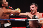 Daniel Geale lands a right on Anthony Mundine during their IBF Middleweight Title bout. Photo / Getty Images