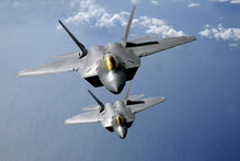 A plunge in defence spending unexpectedly pushed the US economy into negative territory in the last quarter of 2012. Photo / F-22 Raptors / Thinkstock