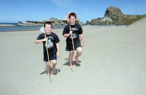 FISHERBOYS: Brothers Jayden, 6, and Connah Rongonui, 9, of Masterton walk up from the lagoon with their fishing nets.