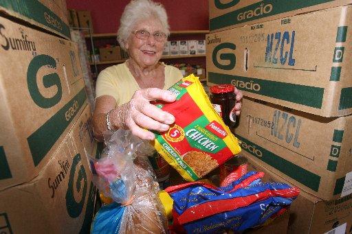 IN NEED: Masterton Food Bank volunteer Linda Bouton packs a food parcel. PHOTO/LYNDA FERINGA