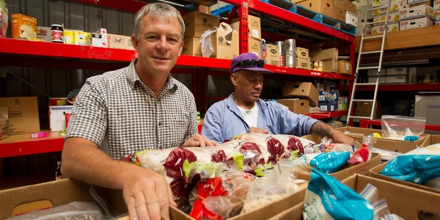 Ian Foster and Felipo Lovi at the South Auckland Christian Foodbank, which puts together up to 60 parcels a week. Photo / Kellie Blizard