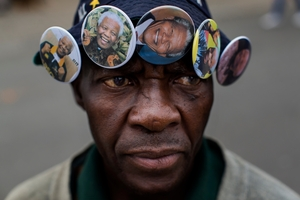 Badges of Nelson Mandela for sale in Soweto. Photo / AP