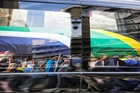 A vehicle carrying the body of Nelson Mandela makes its way through the streets of Pretoria. Photo / AP
