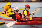 Canoe polo is fast-paced and children often topple the opposition's boats.