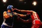 Chris Cairns (blue) and Simon Doull put on a spirited display at the Fight for Life last night. Photo / Getty Images
