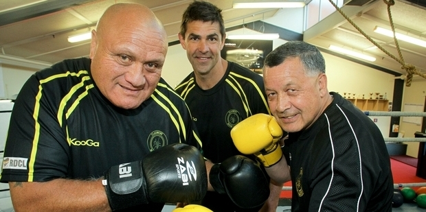 Craig McDougall (middle) with Henare O'Keefe (left) and Allan Brown of U-Turn Trust Flaxmere Boxing Academy, Hastings.