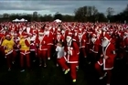 "Thousands of runners dressed as Father Christmas take part in the charity fundraising ""Santa Run"" in Victoria Park, north London, on Sunday, with similar events taking place across Britain."