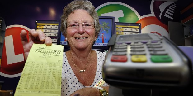 Bayfair Lotto shop assistant Sharyn Burns was flat out checking tickets after news the store had sold a $1million ticket. Photo/George Novak