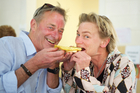 Grant Allen and Pip Wylie get stuck into the demanding roles of judging the whitebait delicacies. Photo / Nick Allan
