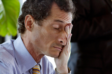 New York mayoral candidate Anthony Weiner rubs his eyes during a candidate forum. Photo / AP