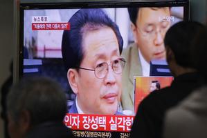 People watch a TV news program showing North Korean leader Kim Jong Un's uncle, Jang Song Thaek. Photo / AP